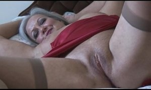 Attractive bust granny in slip and stockings strips