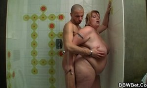 Huge lady is screwed in the shower