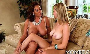 Blonde teen gets intimate with a MILF in a threesome