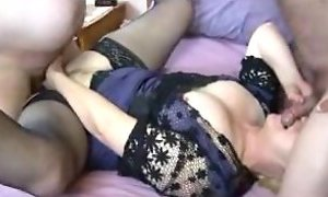 Amateur Granny in lacetop and stockings takes on two boys