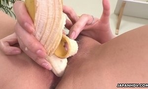 Spoiled Asian wife Nami Aoyama thrusts banana in her wet and whorish pussy